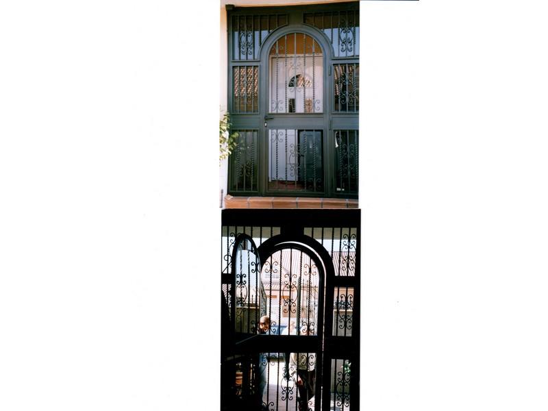 BARROTES FORJA CON ARCO - Puertas de hierro y cristal